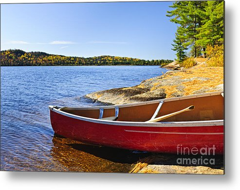 Canoe Metal Print featuring the photograph Red Canoe On Shore by Elena Elisseeva
