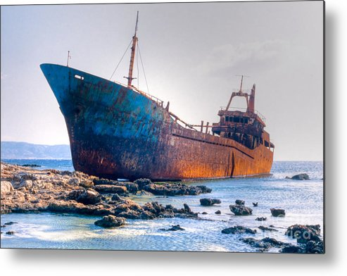 Aground Metal Print featuring the photograph Rusty Old Shipwreck Aground On Rocky Reef by Stephan Pietzko