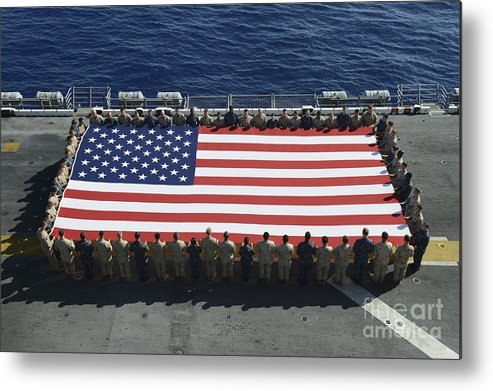 Horizontal Metal Print featuring the photograph Sailors And Marines Display by Stocktrek Images