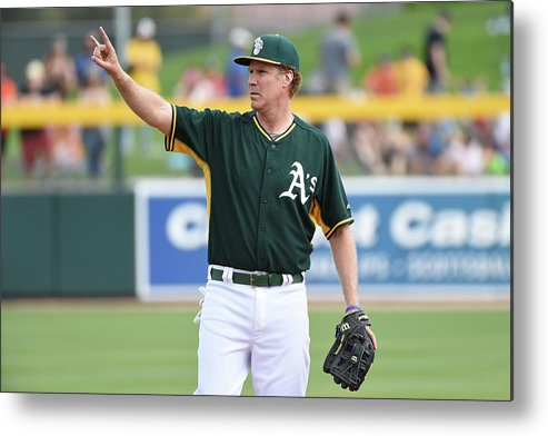 Event Metal Print featuring the photograph Seattle Mariners V Oakland Athletics by Lisa Blumenfeld