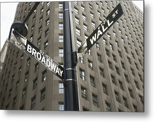 Iconic Metal Print featuring the photograph Signs For Broadway And Wall Street by Marc Jackson