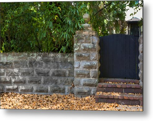 St. Augustine Metal Print featuring the photograph Stone Wall And Gate by Rich Franco