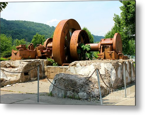 Flywheel Metal Print featuring the photograph The Flywheel by Bobby Cole