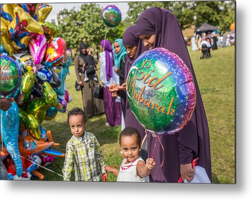 People Metal Print featuring the photograph The Muslim Festival Of Eid Al-fitr Is Celebrated Around The Uk by Rob Stothard