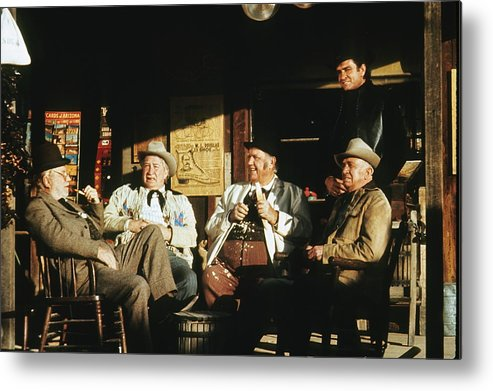 The Over The Hill Gang Johnny Cash Old Tucson Az Western Wear Smoking Whittling Country Store  Porch Edgar Buchanan Chill Wills Andy Devine Walter Brennan  Metal Print featuring the photograph The Over The Hill Gang Johnny Cash Porch Old Tucson Arizona 1971 by David Lee Guss