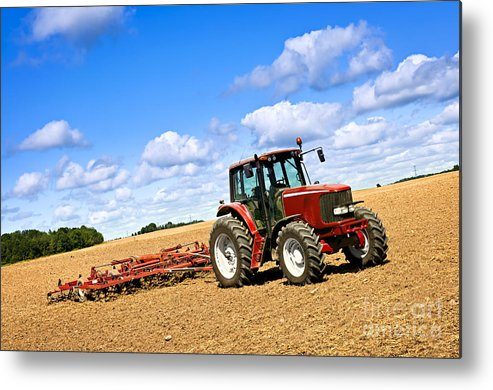Tractor Metal Print featuring the photograph Tractor In Plowed Farm Field by Elena Elisseeva