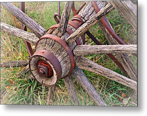 Wagon Wheel Metal Print featuring the photograph Wheel Of Old by Marty Koch