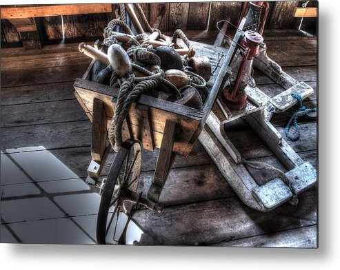 Wheelbarrow Metal Print featuring the photograph Wheelbarrow At Shipyard by Ri Davidson
