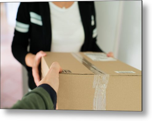 Package Metal Print featuring the photograph Woman Receiving Parcel by Frank Gaertner