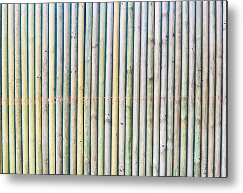Background Metal Print featuring the photograph Wooden Poles by Tom Gowanlock