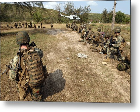 Marine Expeditionary Unit Metal Print featuring the photograph U.s. Marines Provide Security by Stocktrek Images