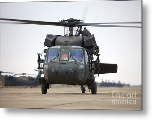 Aviation Metal Print featuring the photograph A Uh-60 Black Hawk Taxis by Terry Moore