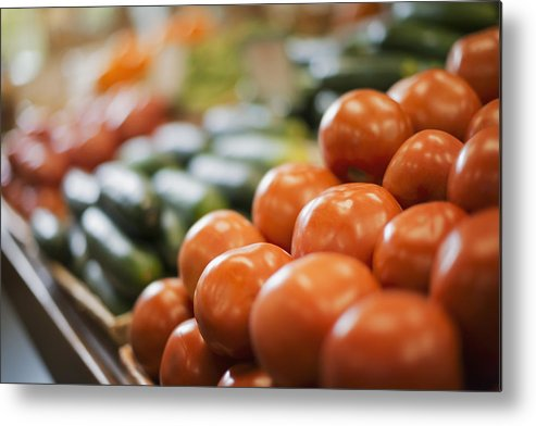 Horizontal Metal Print featuring the photograph A Farm Stand Display Of Fresh Produce Tomatoes And Cucumbers by Mint Images - Tim Pannell
