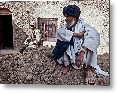 Middle East Metal Print featuring the photograph A Soldier Collects Information by Stocktrek Images