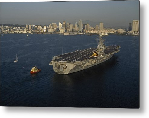 Outdoors Metal Print featuring the photograph An Aircraft Carrier With The Skyline by Phil Schermeister