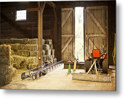 Barn Metal Print featuring the photograph Barn With Hay Bales And Farm Equipment by Elena Elisseeva