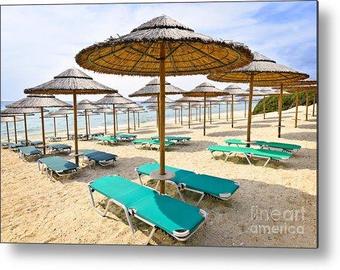 Beach Metal Print featuring the photograph Beach Umbrellas On Sandy Seashore by Elena Elisseeva