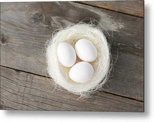 Horizontal Metal Print featuring the photograph Eggs In Nest On Wooden Counter by Stefanie Grewel