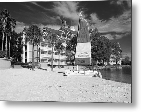 Travelpixpro disney metal print featuring the photograph grand floridian resort beach walt disney world prints black