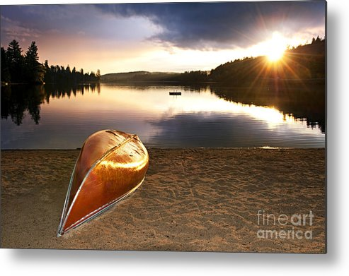Canoe Metal Print featuring the photograph Lake Sunset With Canoe On Beach by Elena Elisseeva