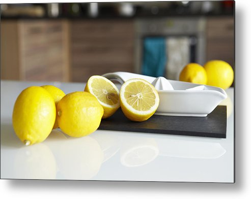 Horizontal Metal Print featuring the photograph Lemons And Juicer On Kitchen Counter by Debby Lewis-Harrison
