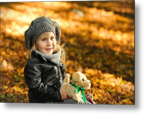 Adorable Metal Print featuring the photograph Little Girl In Autumn Leaves by Waldek Dabrowski