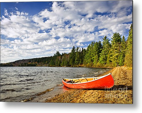Canoe Metal Print featuring the photograph Red Canoe On Lake Shore by Elena Elisseeva