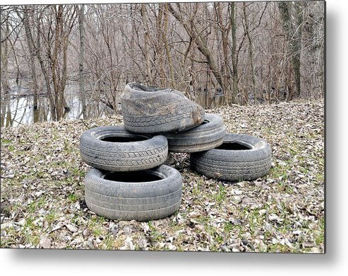 Tires Metal Print featuring the photograph Retired by Robert Comstock