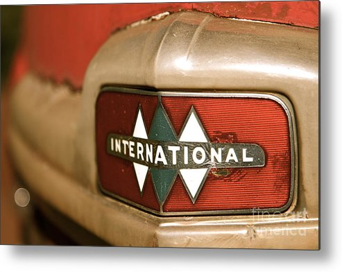 Car Metal Print featuring the photograph Rusted Antique International Car Brand Ornament by ELITE IMAGE photography By Chad McDermott