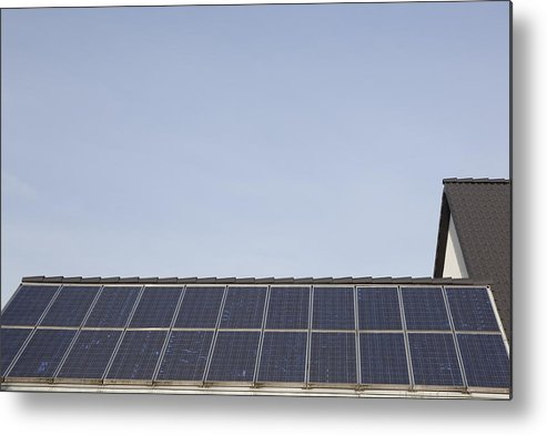 Horizontal Metal Print featuring the photograph Solar Panels On A Roof by Bjorn Holland