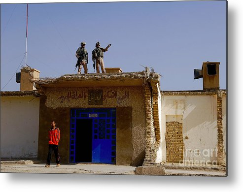 Atop Metal Print featuring the photograph Soldiers Discuss The New Iraqi Police by Stocktrek Images