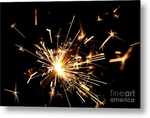 Firework Metal Print featuring the photograph Star In Hand by Catherine Jarret