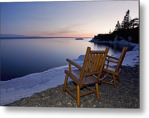 Sunset Metal Print featuring the photograph Two Chairs At Waters Edge Looking Out by Susan Dykstra