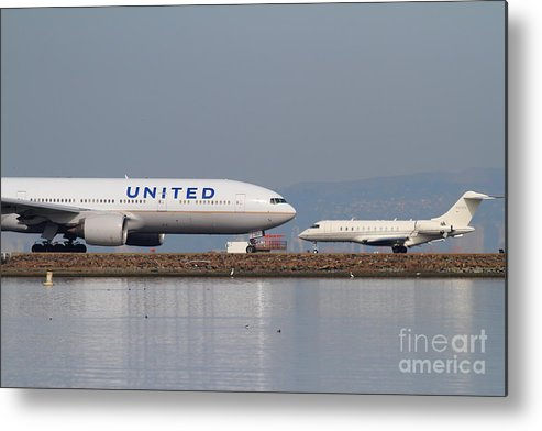 United Metal Print featuring the photograph United Airlines Jet Airplane At San Francisco International Airport Sfo . 7d12081 by Wingsdomain Art and Photography