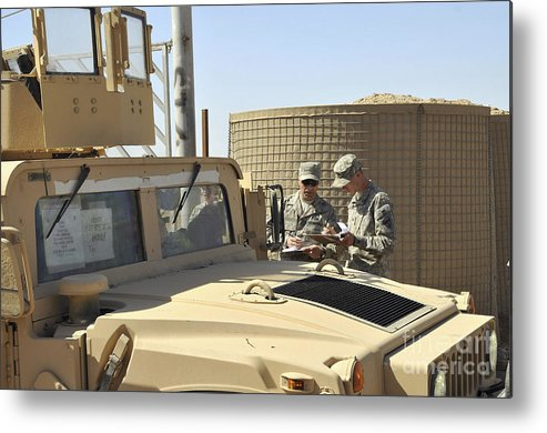 Helping Metal Print featuring the photograph U.s. Army Soldiers Take Accountability by Stocktrek Images