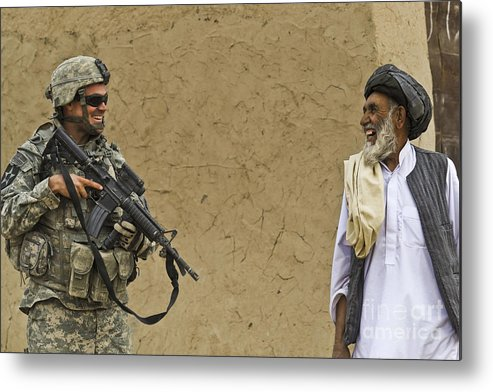 Afghan National Army Metal Print featuring the photograph U.s. Army Specialist Talks To An Afghan by Stocktrek Images