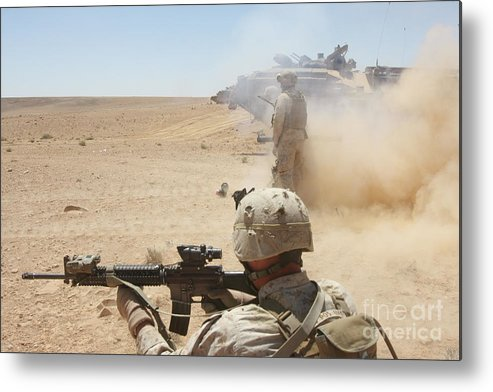 Dust Metal Print featuring the photograph U.s. Marines Fire Several by Stocktrek Images
