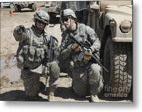 Military Metal Print featuring the photograph U.s. Soldiers Coordinate Security by Stocktrek Images