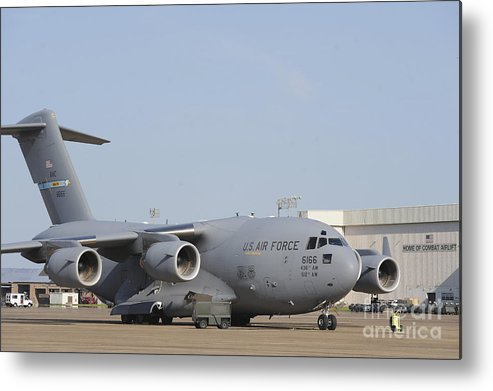 Military Metal Print featuring the photograph A C-17 Globemaster IIi Parked by Stocktrek Images