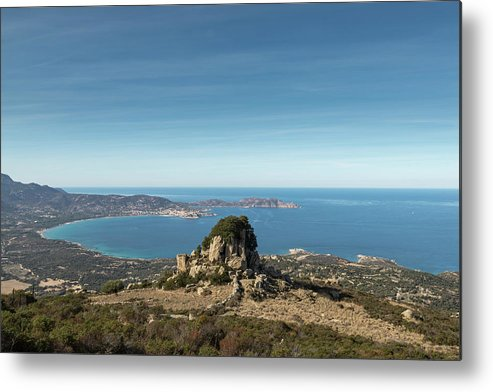 Balagne Metal Print featuring the photograph Rocky Outcrop Above Calvi Bay In Corsica by Jon Ingall