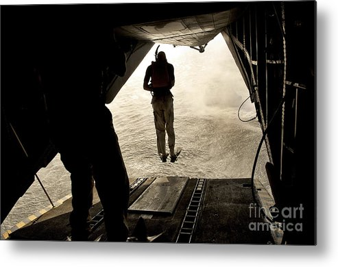 Africa Metal Print featuring the photograph U.s. Air Force Pararescuemen Jump by Stocktrek Images