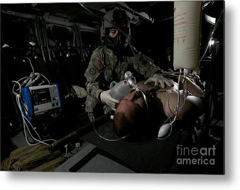 Exercise Angel Thunder Metal Print featuring the photograph Flight Medic Looks After A Mock Patient by Terry Moore
