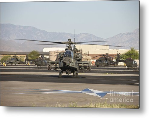 Exercise Angel Thunder Metal Print featuring the photograph Ah-64d Apache Longbow Taxiing by Terry Moore