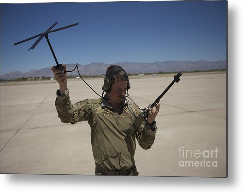 Exercise Angel Thunder Metal Print featuring the photograph Pararescuemen Conducts A Communications by Terry Moore