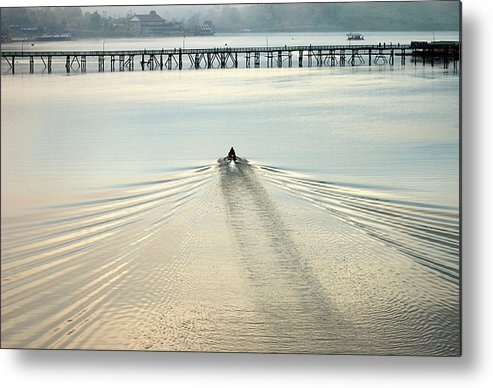 Bridge Metal Print featuring the photograph A Boat Approaching Mon Bridge In Sangkhlaburi by Jirawat Cheepsumol