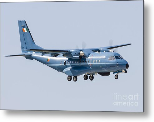 Aircraft Metal Print featuring the photograph A Cn-235 Transport Aircraft by Rob Edgcumbe