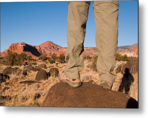 Utah Metal Print featuring the photograph A Hiker Admires The Sunrise Light by Taylor S. Kennedy