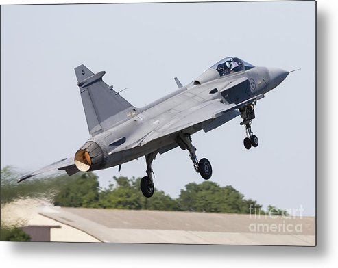 Jas-39 Metal Print featuring the photograph A Jas-39 Gripen Of The Swedish Air by Rob Edgcumbe