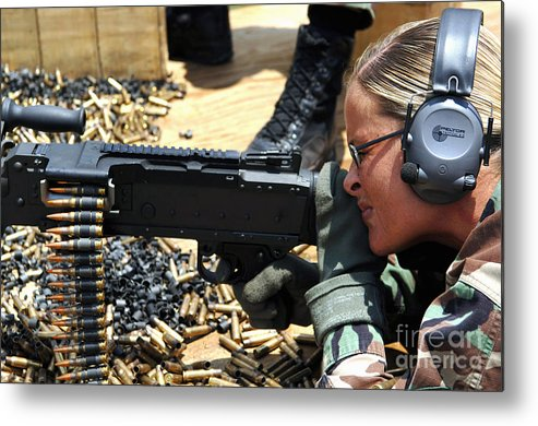 Color Image Metal Print featuring the photograph A Soldier Fires An M240b Medium Machine by Stocktrek Images