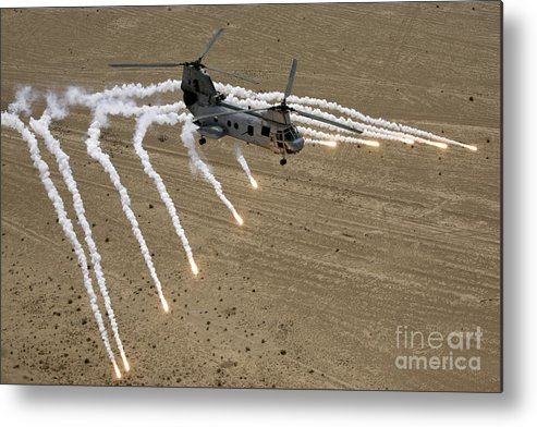 Operation Iraqi Freedom Metal Print featuring the photograph A U.s. Marine Corps Ch-46 Sea Knight by Stocktrek Images